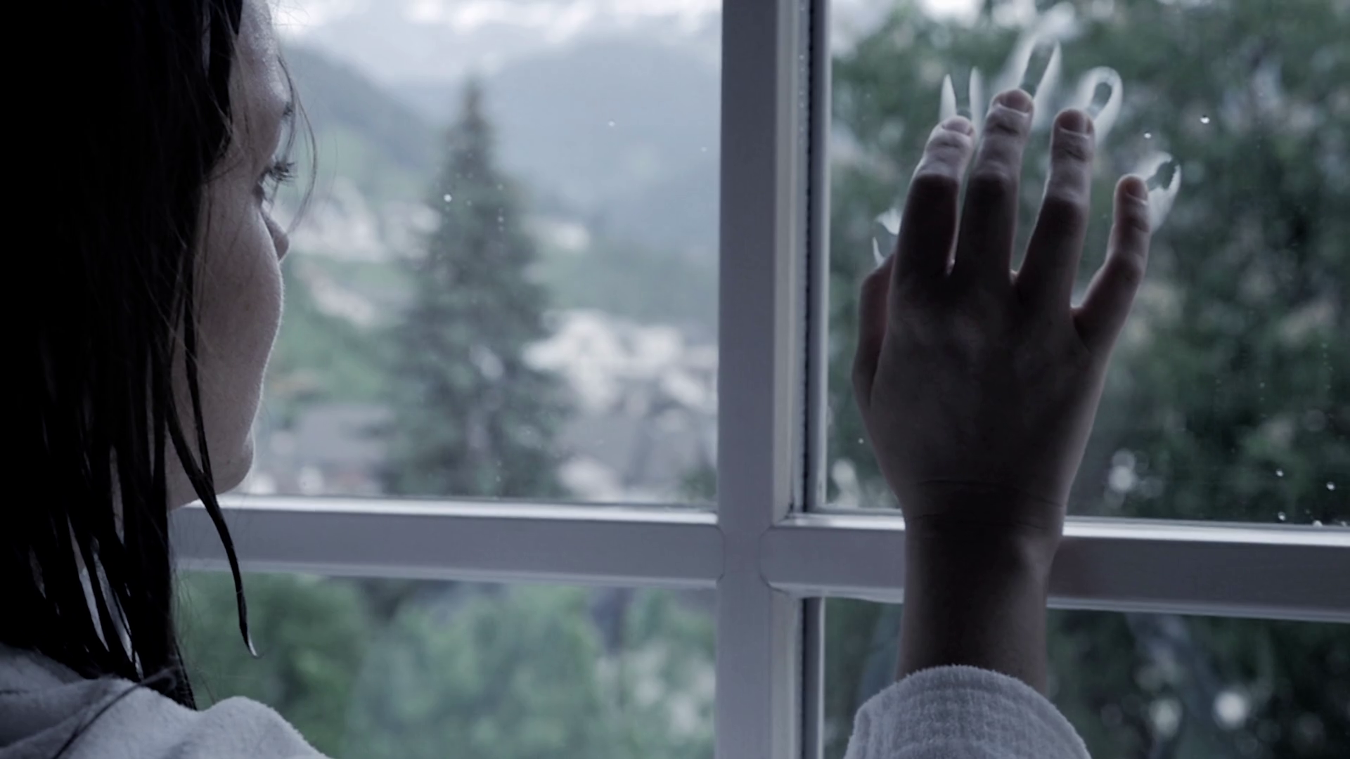 videoblocks-woman-putting-hand-on-window-in-front-of-rain-sad-slow-motion_sduwbzxum_thumbnail-full11